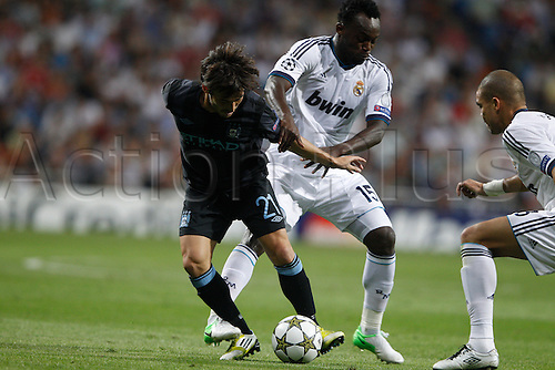 18.09.2012. Madrid. Spain.  Champions League   match played between Real Madrid CF vs  Manchester City at Santiago Bernabeu stadium. The picture show Michale Essien (Ghana midfieldes of Real Madrid) and David Silva (Midfielders of Manchester City) Real Madrid rallied to win the game 3-2.