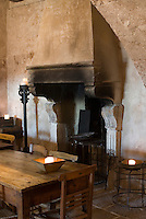 The dining room is dominated by a large fireplace which has been restored preserving its original features