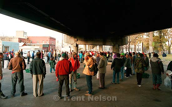 The last Sunday morning breakfast served to the homeless by volunteers under the 400 South viaduct. The viaduct will be torn down as part of the massive freeway construction project.<br />