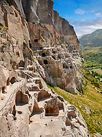 Picture &amp; image of Vardzia medieval cave city and monastery, Erusheti Mountain, southern Georgia (country)<br /> <br /> Inhabited from the 5th century BC, the first identifiable phase of building took place at  Vardzia in the reign of Giorgi III (1156-1184) to be continued by his successor, Queen Tamar 1186, when the Church of the Dormition was carved out of the rock and decorated with frescoes
