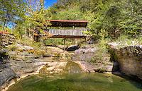 A covered bridge crossing a small creek in Ponca Arkansas.
