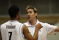 Tall Blacks forward Mike Vukona has a discussion with assistant coach Dillon Boucher during the International basketball match between the NZ Tall Blacks and Australian Boomers at TSB Bank Arena, Wellington, New Zealand on 25 August 2009. Photo: Dave Lintott / lintottphoto.co.nz