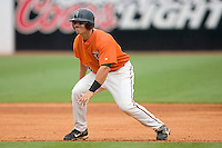 Jake Smolinski #18 of the Greensboro Grasshoppers takes his lead off of second base versus the Kannapolis Intimidators at NewBridge Bank Park June 20, 2009 in Greensboro, North Carolina. (Photo by Brian Westerholt / Four Seam Images)
