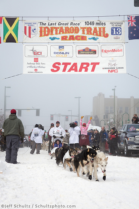 Aaron Burmeister and team leave the ceremonial start line at 4th Avenue and D street in downtown Anchorage during the 2013 Iditarod race. Photo by Jim R. Kohl/IditarodPhotos.com