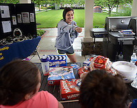 Lauren Navarrete. 22, plays Guesstures as she participates in the Great American Campout Saturday June 27, 2015 in Middletown Twp., Pennsylvania. . (Photo by William Thomas Cain)