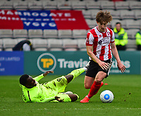 Lincoln City's Alex Woodyard vies for possession with York City's Amari Morgan-Smith<br /> <br /> Photographer Andrew Vaughan/CameraSport<br /> <br /> Buildbase FA Trophy Semi Final Second Leg - Lincoln City v York City - Saturday 18th March 2017 - Sincil Bank - Lincoln<br />  <br /> World Copyright &copy; 2017 CameraSport. All rights reserved. 43 Linden Ave. Countesthorpe. Leicester. England. LE8 5PG - Tel: +44 (0) 116 277 4147 - admin@camerasport.com - www.camerasport.com