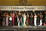 Taiwan based fashion designer, Alexander King Chen stands with models for the close of his Spring 2015 collection fashion show, for the Celebrate Taiwan event in Grand Central Terminal on September 27, 2014.
