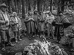 Billy Butler, Mrs. Desin, Anne Adams Helms Ansel&rsquo;s daughter, Ken Helms, Sylvia Mayhew Desin Ansel&rsquo;s granddaughter, Mitzi Hall, and Virginia Mayhew Ansel&rsquo;s granddaughter get warmed by campfire.<br /> <br /> In August of 1987, the family and friends of Ansel Adams made a trip to Mount Ansel Adams to honor Ansel by putting his ashes on the mountain.  Leading the trip were Dr. Michael Adams and his wife, Jeanne, their son, Matthew, and daughter, Sarah.  Also in the group were Ansel&rsquo;s daughter, Anne Adams Helms, and her husband, Ken Helms, and Anne's daughters, Virginia (Ginny) Mayhew and Sylvia Mayhew Desin, and Sylvia&rsquo;s husband, Greg Desin.  Other members of the trip were Roger and Mitzi Hall, Matt Weston, Mrs. Desin (Greg&rsquo;s mother), and Billy Butler.  The Adams family invited me along with Leo Stutzin (Modesto Bee reporter) and my eldest son, Aaron Golub.  <br /> <br /> With some of us on horseback and others on foot, we began the hike at Tuolumne High Sierra Camp and headed to Vogelsang High Sierra Camp for the first night out.  The second day, we began by climbing through Vogelsang Pass, then descended by switchback down to Lewis Creek.  After climbing up from the creek we hiked by the Cony Crags before descending into the Lyell Fork of the Merced River ending up near Hutchings Creek at what is now referred to as the Ansel Adams Camp.  <br /> <br /> This camp was originally known generically as a Sierra Club Camp, but has more recently been referred to as Ansel Adams Camp because in 1934, Ansel led a Sierra Club outing to the Lyell Fork of the Merced River.  After the group climbed the then-unnamed peak that Adams called &ldquo;The Tower in Lyell Fork,&quot; they gathered around the campfire and agreed that the peak should bear Ansel&rsquo;s name.  The U.S. Geological Survey does not, however, permit naming features for living individuals, so the peak did not officially become Mt. Ansel Adams until 1985, one year and one day after his death.  Photo by Al Golub/Golub Photography