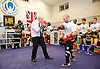Boris Johnson <br /> Mayor of London <br /> visiting a boxing academy  - Fight For Peace in North Woolwich, London, Great Britain <br /> 28th October 2014 <br /> <br /> Boris Johnson <br /> Mayor of London <br /> boxing with Steve O'Keeffe - assistant sports co-ordinator <br /> <br /> also with Marigold Ride - Head of Programmes <br /> <br /> Photograph by Elliott Franks <br /> Image licensed to Elliott Franks Photography Services