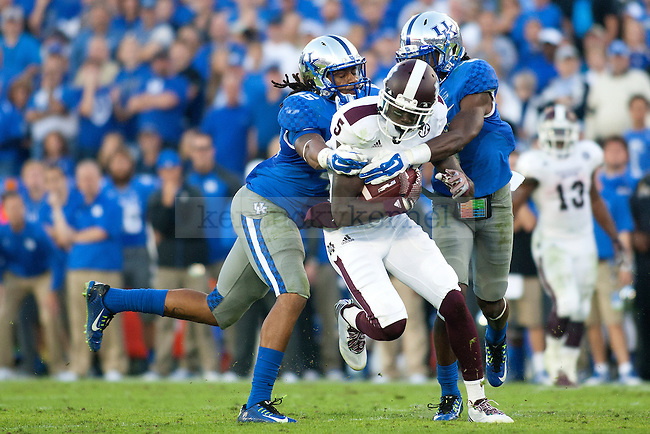 Cornerback Fred Tiller (3) and linebacker Josh Forrest (45) of the Kentucky Wildcats tackle wide receiver Fred Brown during the second half of the game against the Mississippi State Bulldogs at Commonwealth Stadium on Saturday, October 25, 2014 in Lexington, Ky. Mississippi State defeated Kentucky 45-31. Photo by Michael Reaves | Staff