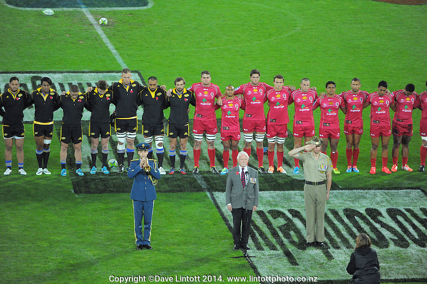 The teams links arms as The Last Post is played before the Super Rugby match between the Hurricanes and Reds at Westpac Stadium, Wellington, New Zealand on Saturday, 26 April 2014. Photo: Dave Lintott / lintottphoto.co.nz