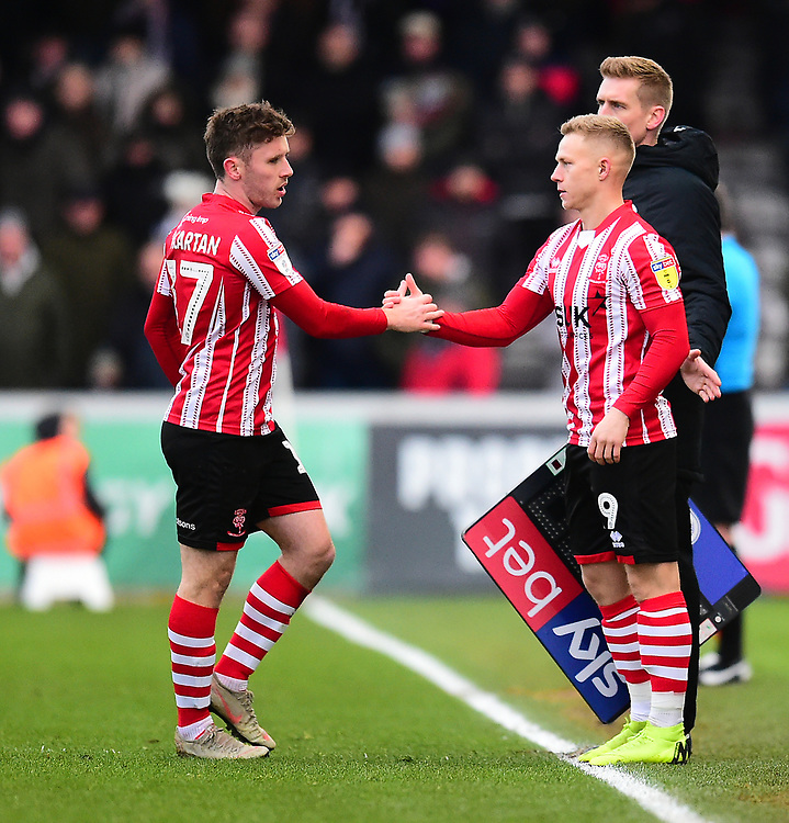 Lincoln City's Shay McCartan, left, is replaced by Danny Rowe<br /> <br /> Photographer Andrew Vaughan/CameraSport<br /> <br /> The EFL Sky Bet League Two - Lincoln City v Grimsby Town - Saturday 19 January 2019 - Sincil Bank - Lincoln<br /> <br /> World Copyright &copy; 2019 CameraSport. All rights reserved. 43 Linden Ave. Countesthorpe. Leicester. England. LE8 5PG - Tel: +44 (0) 116 277 4147 - admin@camerasport.com - www.camerasport.com
