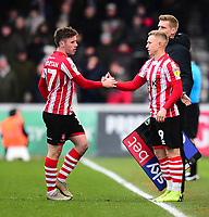 Lincoln City's Shay McCartan, left, is replaced by Danny Rowe<br /> <br /> Photographer Andrew Vaughan/CameraSport<br /> <br /> The EFL Sky Bet League Two - Lincoln City v Grimsby Town - Saturday 19 January 2019 - Sincil Bank - Lincoln<br /> <br /> World Copyright © 2019 CameraSport. All rights reserved. 43 Linden Ave. Countesthorpe. Leicester. England. LE8 5PG - Tel: +44 (0) 116 277 4147 - admin@camerasport.com - www.camerasport.com