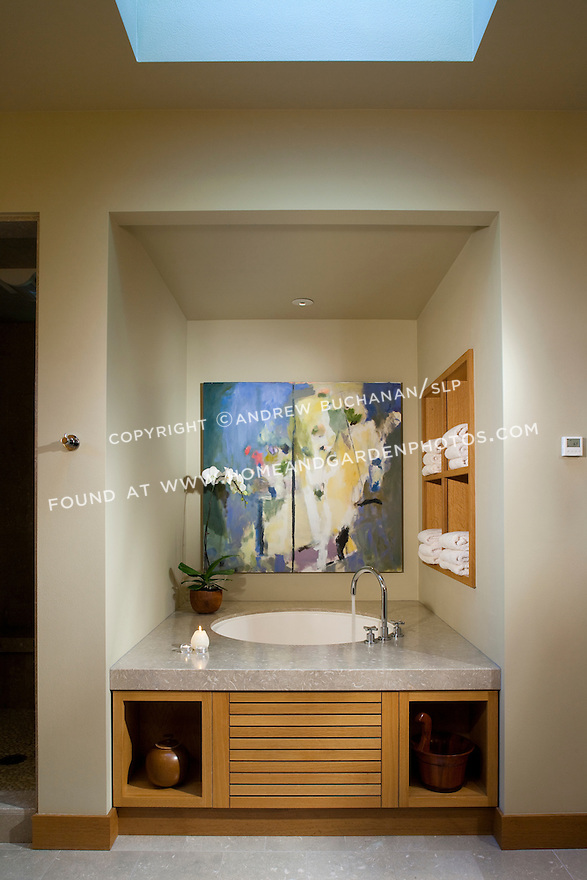 Water fills a Japanese soaking tub in a Pacific Northwest bathroom. this image is available through an alternate architectural stock image agency, Collinstock located here: http://www.collinstock.com