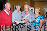 l-r: Seamus Callaghan with Sean and Gerard Griffin and Siobhan Barry (nee Godley) looking back at old B&W photo's from their days at the Banna National School reunion night held at the Ballyroe Hts Hotel, Tralee last Friday.