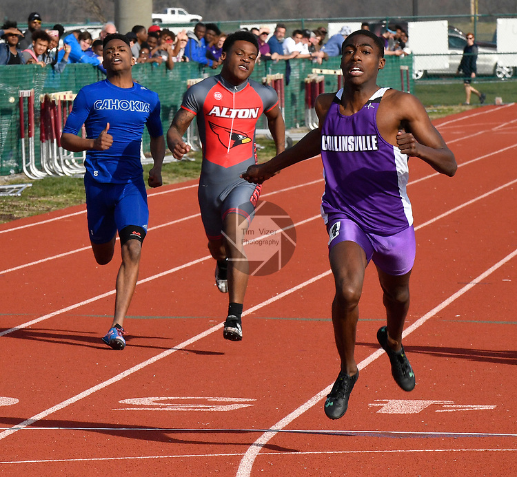 Jermarrion Stewart of Collinsville (right) won the 200 meter race at the Norm Armstrong BoysTrack and Field Invitational on Wednesday April 11, 2018. Also shown are Cahokia's Damonta Taylor and Alton's Earlie Brown. Photo by Tim Vizer