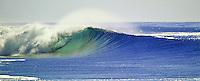 large sets of waves break along the tropical island coast