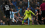 David Silva of Manchester City stretches to score the second goal past Adrian of West Ham United during the premier league match at the Etihad Stadium, Manchester. Picture date 3rd December 2017. Picture credit should read: Andrew Yates/Sportimage
