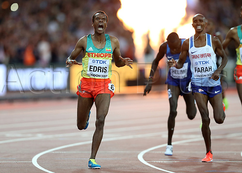 August 12th 2017, London Stadium, East London, England; IAAF World Championships, Day 9; Muktar Edris of Ethiopia celebrates crossing the finishing line in 1st place to become World Champion of the 5000 metres men final with Mo Farah of Great Britain looking on in dispair as he finishes in 2nd place