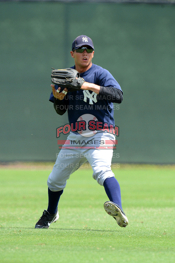 GCL Yankees 2 outfielder Jose Figueroa (77) during practice before a game against the GCL Phillies on July 22, 2013 at Carpenter Complex in Clearwater, Florida.  GCL Yankees defeated the GCL Phillies 2-1.  (Mike Janes/Four Seam Images)