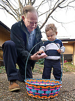 NWA Democrat-Gazette/BEN GOFF -- 03/21/15 Stephen LaDue of Bella Vista helps his son James Stephen LaDue, 1, open the eggs he collected during the pancake breakfast and Easter egg hunt at First United Methodist Church of Bella Vista on Saturday, Mar. 21, 2015.