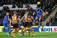 Bolton Wanderers' Mark Beevers heads at goal under pressure from  Hull City's Eric Lichaj<br /> <br /> Photographer Andrew Kearns/CameraSport<br /> <br /> The EFL Sky Bet Championship - Hull City v Bolton Wanderers - Tuesday 1st January 2019 - KC Stadium - Hull<br /> <br /> World Copyright © 2019 CameraSport. All rights reserved. 43 Linden Ave. Countesthorpe. Leicester. England. LE8 5PG - Tel: +44 (0) 116 277 4147 - admin@camerasport.com - www.camerasport.com