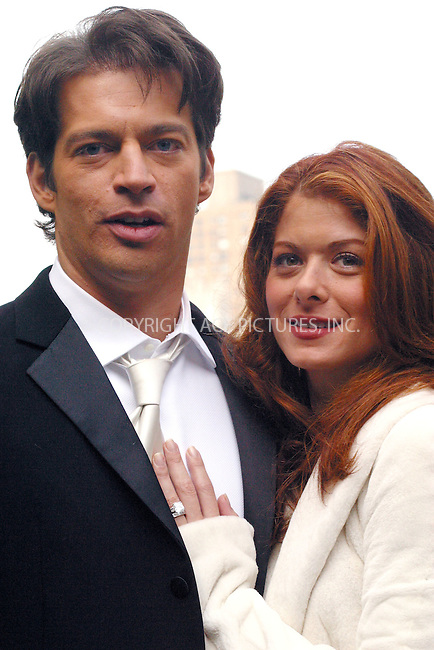 "Harry Connick Jr. and Debra Messing pose for photographers and share a kiss as they take a break from filming ""Will & Grace"" in Central Park, New York. November 4, 2002. Please byline: Alecsey Boldeskul/NY Photo Press.   ..*PAY-PER-USE*      ....NY Photo Press:  ..phone (646) 267-6913;   ..e-mail: info@nyphotopress.com"