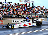 Jul 23, 2016; Morrison, CO, USA; Crew member with NHRA top fuel driver Richie Crampton during qualifying for the Mile High Nationals at Bandimere Speedway. Mandatory Credit: Mark J. Rebilas-USA TODAY Sports