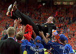 Dick Advocaat hoisted up by the Rangers players as they party in a sea of Orange as tribute to the dutch connection, Aberdeen v Rangers Scottish Cup Final 2000