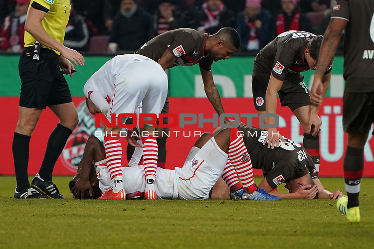 08.02.2019, RheinEnergieStadion, Koeln, GER, 2. FBL, 1.FC Koeln vs. FC St. Pauli,<br />  <br /> DFL regulations prohibit any use of photographs as image sequences and/or quasi-video<br /> <br /> im Bild / picture shows: <br /> Jhon C&oacute;rdoba (FC Koeln #15),  Florian Carstens (St Pauli #38),  verletzt am Boden <br /> <br /> Foto &copy; nordphoto / Meuter