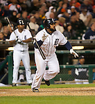 September 18, 2012:  Detroit Tigers first baseman Prince Fielder watches his home run clear the right field wall in a game against the Oakland Athletics at Comerica Park in Detroit, Michigan. (Photo by Bob Campbell)