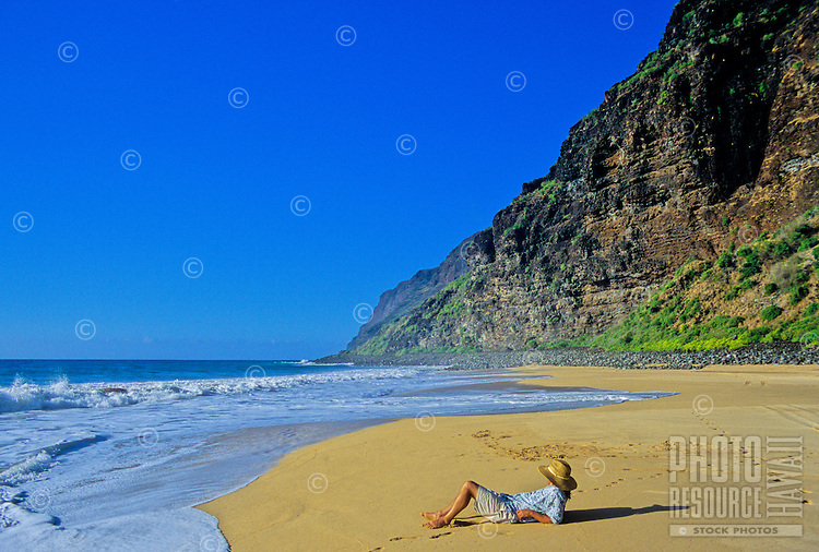 Tourist relaxes at the beach at Polihale State Park