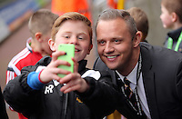 Swansea club ambassador Lee Trundle with child mascot before the Barclays Premier League match between Swansea City and Crystal Palace at the Liberty Stadium, Swansea on February 06 2016