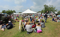 Pictured: People enjoy the sunshine on the festival green Monday 30 May 2016<br />