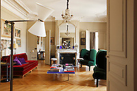 In the large and spacious drawing room the antique fireplace is flanked by an elegant pair of double doors