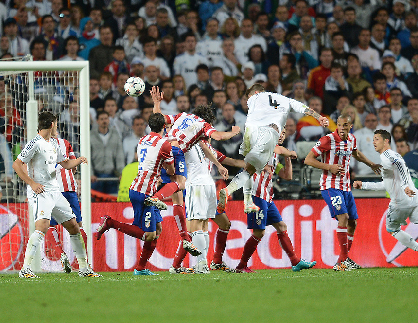 Real Madrid's Sergio Ramos scores his sides equalising goal to make the score 1-1<br /> <br /> Photographer Ian Cook/CameraSport<br /> <br /> Football - UEFA Champions League Final 2014 - Real Madrid v Atletico Madrid - Saturday 24th May 2014 - Stadium of Light - Lisbon - Portugal<br /> <br /> &copy; CameraSport - 43 Linden Ave. Countesthorpe. Leicester. England. LE8 5PG - Tel: +44 (0) 116 277 4147 - admin@camerasport.com - www.camerasport.com