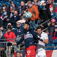 FOXBOROUGH, MA - MARCH 7: Teal Bunbury #10 of New England Revolution and Brandt Bronico #13 of Chicago Fire battle for head ball during a game between Chicago Fire and New England Revolution at Gillette Stadium on March 7, 2020 in Foxborough, Massachusetts.