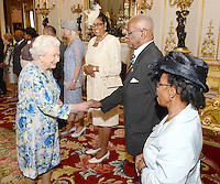 10 June 2016 - London, England - Queen Elizabeth II shakes hands with Sir Elliott Belgrave of Barbados, during a reception ahead of the Governor General's lunch at Buckingham Palace in London. Photo Credit: ALPR/AdMedia