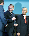 April 25, 2016, Tokyo, Japan - Designer Asao Tokolo, center, the winning designer of the logos for the 2020 Tokyo Olympics and Paralympics, receives words of congratulation from an unidentified official in Tokyo on Monday, April 25, 2016. Tokolos stark indigo-and-white checkered patterns now have officially become the emblems for the 2020 Tokyo Games. (Photo by Natsuki Sakai/AFLO) AYF -mis-