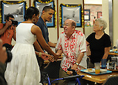 Kaneohe, HI - December 25, 2009 -- United States President Barack Obama and first lady Michelle Obama greet people at Anderson Hall located at Kaneohe Marine Corps Base Hawaii, Kaneohe, Hawaii, Christmas Day, Friday, December 25, 2009.Credit: Cory Lum / Pool via CNP