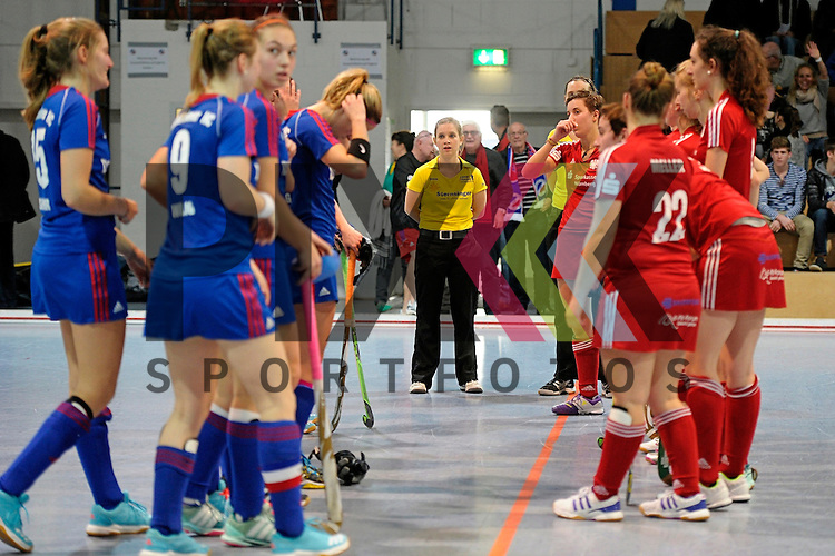 GER - Mannheim, Germany, December 19: During the 1. Bundesliga Sued Damen indoor hockey match between Mannheimer HC (blue) and Nuernberger HTC (red) on December 19, 2015 at Irma-Roechling-Halle in Mannheim, Germany. Final score 8-2 (HT 3-2). <br /> <br /> Foto &copy; PIX-Sportfotos *** Foto ist honorarpflichtig! *** Auf Anfrage in hoeherer Qualitaet/Aufloesung. Belegexemplar erbeten. Veroeffentlichung ausschliesslich fuer journalistisch-publizistische Zwecke. For editorial use only.