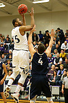 SIOUX FALLS, SD, FEBRUARY 10:  Daniel Hurtt #15 from the University of Sioux Falls shoots over Mike Busack #4 from Augustana Friday night at the Stewart Center in Sioux Falls. (Photo by Dave Eggen/Inertia)