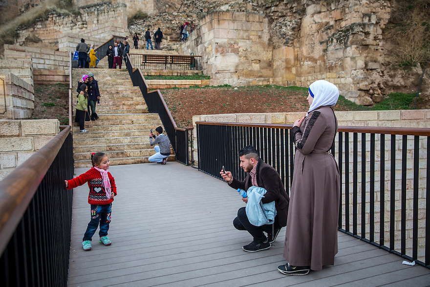 A Syrian family visit the castle in the old city of Gaziantep, Turkey, which is similar to the castle in Aleppo, Syria, 120 km to the south.