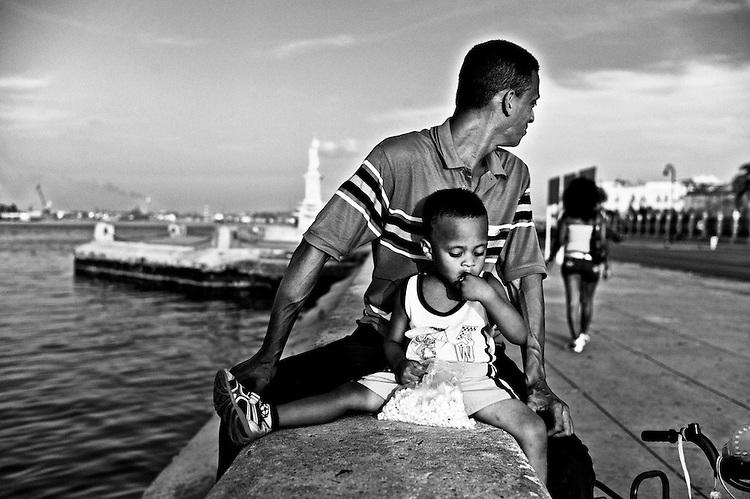 Images from the old Havana, Cuba. ..The malecon, that spans for over 4.5 kms along the coast of Havana, it's a gathering place for people as the sun sets down.  The breeze (which combats the otherwise overwhelming heat of the city), the fishing and not least important the people watching make up fro a great afternoon activity.