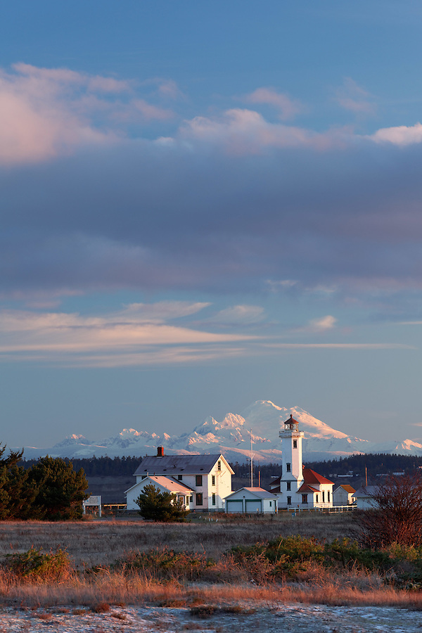 Point Wilson Lighthouse and Mount Baker at sunrise, Fort Worden State Park, Port Townsend, Washington, USA