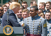 United States President Donald J. Trump recognizes quarterback and co-Captain Ahmad Bradshaw (17) as he presents the Commander-in-Chief's Trophy to the U.S. Military Academy football team in the Rose Garden of the White House in Washington, DC on Tuesday, May 1, 2018.  The Commander-in-Chief's trophy is presented to the winner of the annual Army-Navy football game which was played at Lincoln Financial Field in Philadelphia, Pennsylvania on December 9, 2017.  The Army Black Knights beat the Navy Midshipmen 14 - 13.<br /> Credit: Ron Sachs / CNP