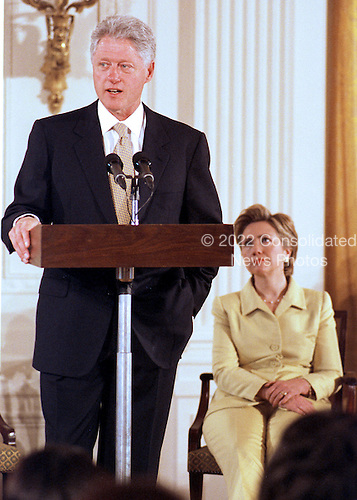"United States President Bill Clinton makes remarks to open the ""White House Conference on Teenagers: Raising Responsible and Resourceful Youth"" in Washington, DC on 2 May, 2000.  First Lady Hillary Rodham Clinton is at right.<br /> Credit: Ron Sachs / CNP"