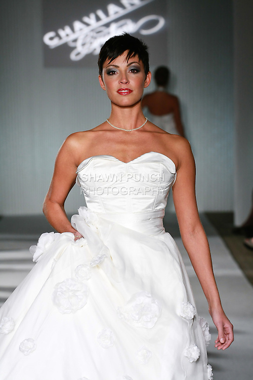 Model walks the runway in a Chaviano Couture Ana Rosa wedding dress by Annette Thurmon, during the Wedding Trendspot Spring 2011 Press Fashion show, October 17, 2010.