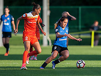Kansas City, MO - Sunday July 02, 2017:  Lo'eau Labonta gains control of the ball from Poliana Barbosa Medeiros during a regular season National Women's Soccer League (NWSL) match between FC Kansas City and the Houston Dash at Children's Mercy Victory Field.