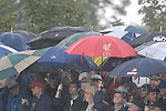 Ryder Cup 206 K Club, Straffan, Ireland..Ryder Cup fans take shelter again during the morning fourballs session of the second day of the 2006 Ryder Cup at the K Club in Straffan, Co Kildare, in the Republic of Ireland, 23 September 2006...Photo: Eoin Clarke/ Newsfile.